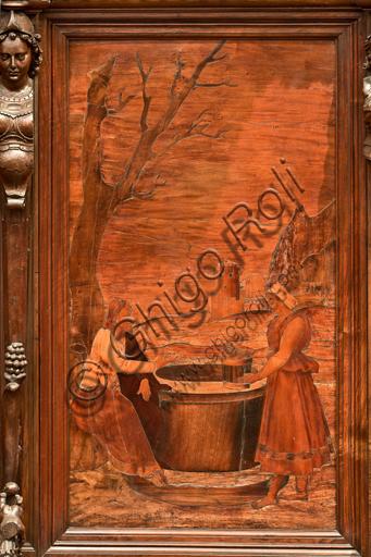"""Genova, Duomo (Cattedrale di S. Lorenzo), interno,  presbiterio, abside, coro, lato sud: """"Cristo e la Samaritana al pozzo"""", tarsia lignea di Gian Michele De' Pantaleoni (secolo XVI)."""