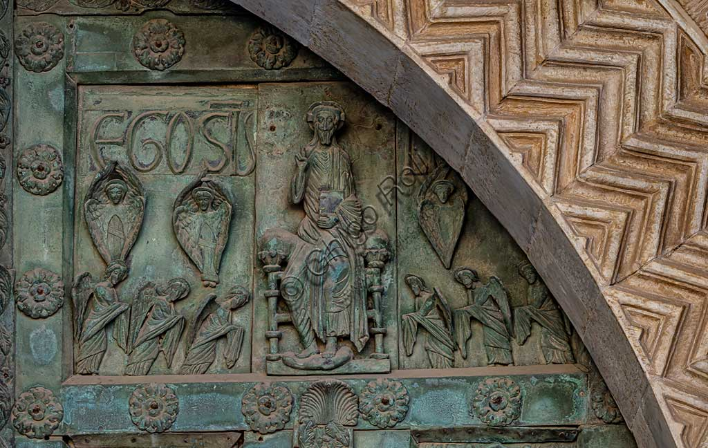 "Monreale Cathedral, the gate by Bonanno Pisano (1185-6): bronze tile depicting ""Enthroned Christ"" (scene of the New Testament).The gate is signed ""Bonanno civis pisanus"". It depicts five scenes of the Old Testament at the bottom, starting with Adam and Eve, and five scenes of the New Testament at the top, ending in ""Christ and Mary in the glory of Paradise""."