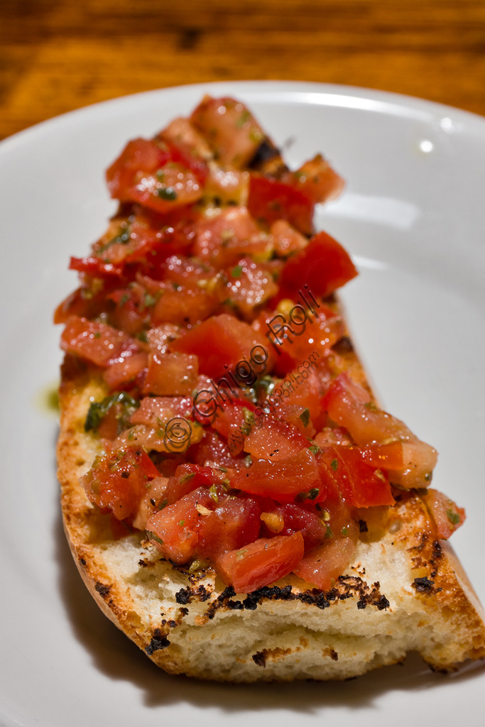 Typical Tuscany cuisine: tomato bruschetta (toasted bread seasoned with oil and sliced tomatoes)