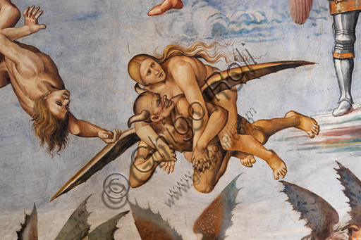 """Orvieto,  Basilica Cathedral of Santa Maria Assunta (or Duomo), the interior, Chapel Nova or St. Brizio Chapel, the lunette of the east wall: """"Damned to hell"""", fresco by Luca Signorelli, (1500 - 1502). Detail of the flying demon that carries a prosperous sinner on his shoulders  and looks back towards her grinning, evidently satisfied with the prey."""