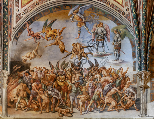 """Orvieto,  Basilica Cathedral of Santa Maria Assunta (or Duomo), the interior, Chapel Nova or St. Brizio Chapel, the lunette of the east wall: """"Damned to hell"""", fresco by Luca Signorelli, (1500 - 1502)."""
