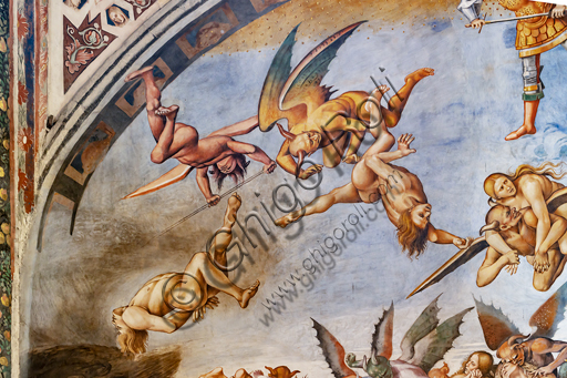 """Orvieto,  Basilica Cathedral of Santa Maria Assunta (or Duomo), the interior, Chapel Nova or St. Brizio Chapel, the lunette of the east wall: """"Damned to hell"""", fresco by Luca Signorelli, (1500 - 1502). Detail with devils and damned."""