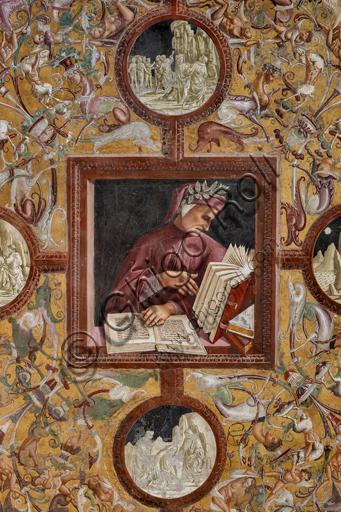 """Orvieto, Basilica Cattedrale di Santa Maria Assunta (o Duomo), interno, Cappella Nova o di San Brizio, parte inferiore delle pareti, serie dei Personaggi illustri dove ogni figura è circondata da tondi in monocromo che hanno la funzione di identificare il personaggio attraverso la rappresentazione di episodi tratti dalle sue opere: """"Dante intento alla lettura delle sue opere""""."""