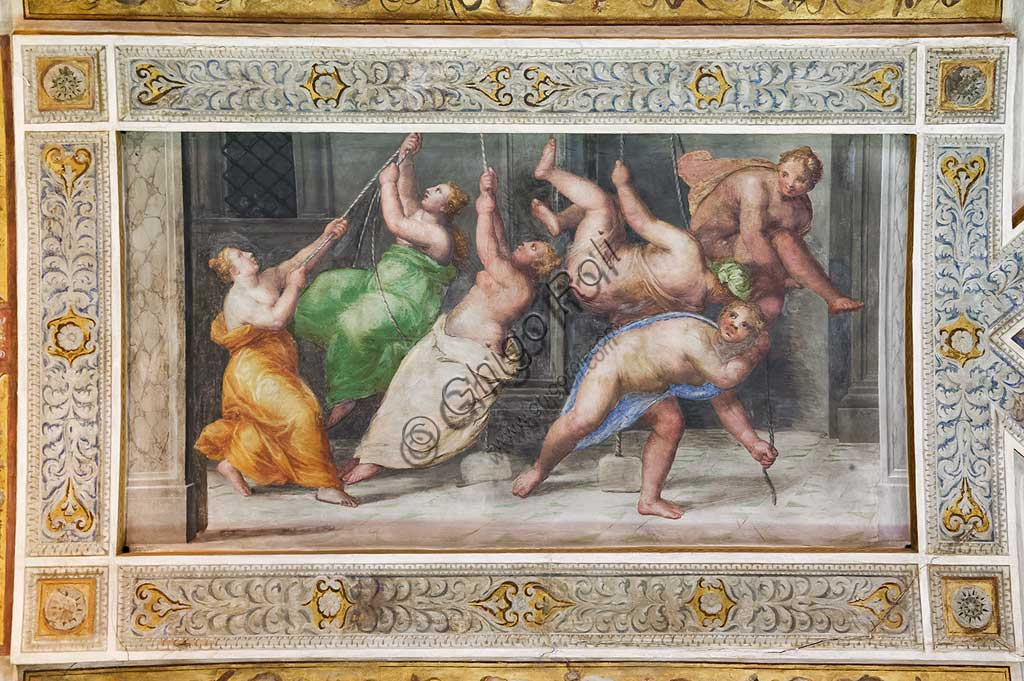 """Ferrara, the Castello Estense (the Estense Castle), also known as Castle of St. Michael: detail of the ceiling of the Hall of Games,""""The Pyrrhichios dance"""". The frescoes are designed by Pirro Ligorio. The realization  is by Ludovico Settevecchi."""