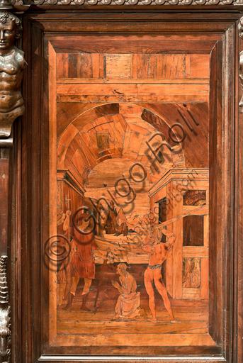 """Genova, Duomo (Cattedrale di S. Lorenzo), interno, abside, coro, lato nord: """"La decollazione del Battista"""", tarsia lignea di Giovanni Francesco Zambelli (secolo XVI)."""