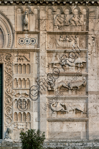 Spoleto, St. Peter's Church: the façade. It is characterized by Romanesque reliefs (XII century).  Detail of the five bas-reliefs to the right of the main portal. From above: Christ washing St. Peter's feet; Vocation of Saints Peter and Andrew; Fable of the fake dead fox and crows; Fable of the student wolf and the ram (probable satire of the monastic life), Gryphon - Chimera pursued by a lion.