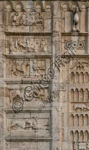 Spoleto, St. Peter's Church: the façade. It is characterized by Romanesque reliefs (XII century).  Detail of the five bas-reliefs to the left of the main portal. From above: Death of the righteous, Death of the sinner, Man defending himself against a lion, Man begging a lion, Warrior attacked by a lion.
