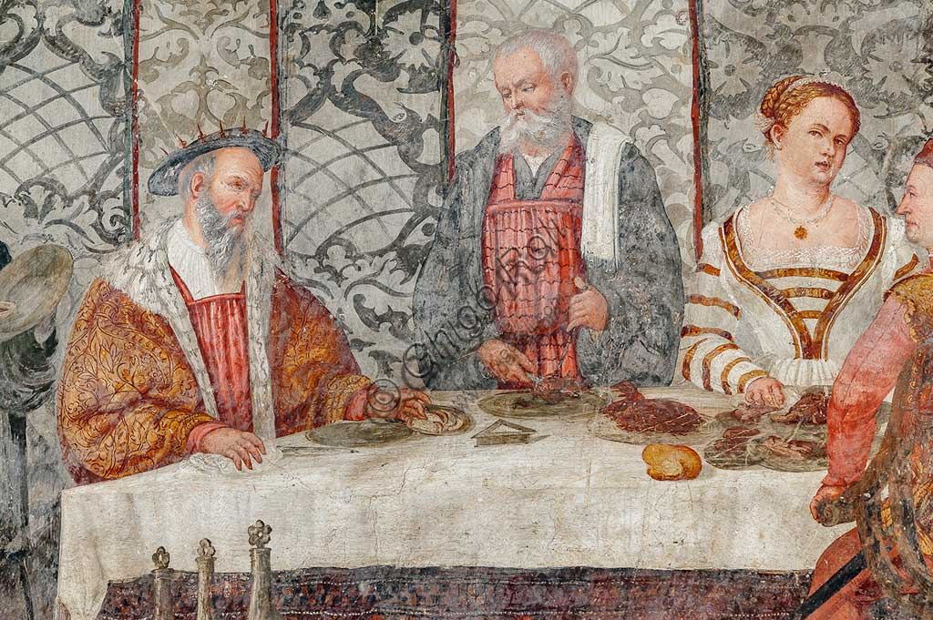 Cavernago, Malpaga Castle or Colleoni Castle, Hall of Honour: cycle of frescoes depicting the visit of Christian I of Denmark to Bartolomeo Colleoni, by Marcello Fogolino, (some historians attribute these frescoes to Romanino), 1474. Detail of the banquet.
