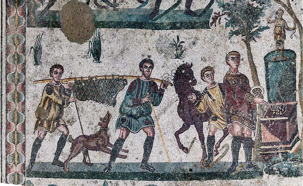 Piazza Armerina, Roman Villa of Casale, which was probably an imperial urban palace. Today it is a UNESCO World Heritage Site. Detail of the floor mosaic in the corridor of the Grat Hunt. Detail with  the capture of a  wild boar.In spite of the name with which it is known (The Great Hunt), the subject of the floor mosaic represents a great capture. It does not represent  hunting.Wild beasts are captured for the games in the amphitheatres of the Roman Empire: no animal is in fact shot down and hunters use only weapons to defend themselves.