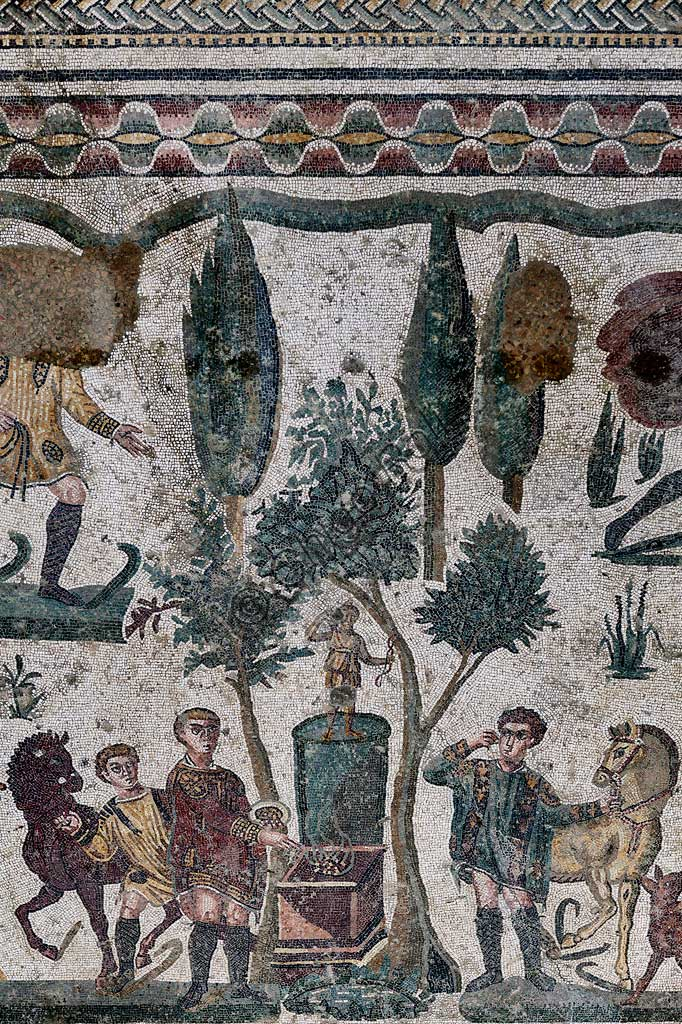 Piazza Armerina, Roman Villa of Casale, which was probably an imperial urban palace. Today it is a UNESCO World Heritage Site. Detail of the floor mosaic in the corridor of the Grat Hunt. In spite of the name with which it is known (The Great Hunt), the subject of the floor mosaic represents a great capture. It does not represent  hunting.Wild beasts are captured for the games in the amphitheatres of the Roman Empire: no animal is in fact shot down and hunters use only weapons to defend themselves.