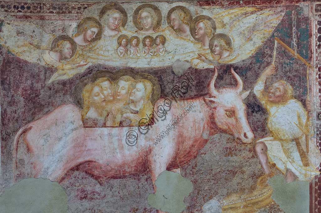 "Codigoro, Pomposa Abbey, interior of the Basilica of Santa Maria, apse: frescoes by Vitale da Bologna. Detail of the lower register with ""the martyrdom of St. Eustace, tortured in a bronze ox with his wife and children""."