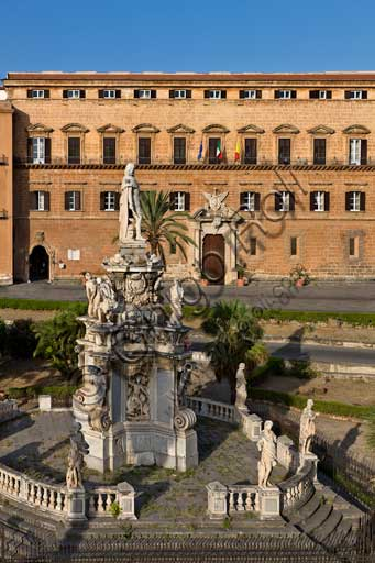 Palermo, The Royal Palace or Palazzo dei Normanni (Palace of the Normans), North-East side: view of the Renaissance wing and the Pisan Tower from Parliament Square. In the foreground, detail of the Marble Theatre, by Gaspare Guercio, Carlo D'Aprile and Gaspare Serpotta, realized to celebrate the glory of Philip IV of Habsburg, king of Spain and Sicily, called Philip the Great.