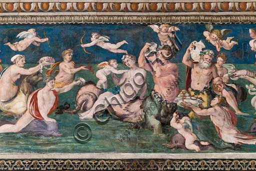 "Rome, Villa Farnesina, The Hall of Perspectives: the ample frieze with mythological scenes inspired by the Ovid  Metamorphoses. Frescoes by Baldassarre Peruzzi and workshop (1517-18). Detail of ""Triumph of Venus"", marine scene with dolpnins and cupids. Venus is surrounded by nymphs and tritons, all paying tribute to the goddess of love, offering corals, shellfish and crustaceans."