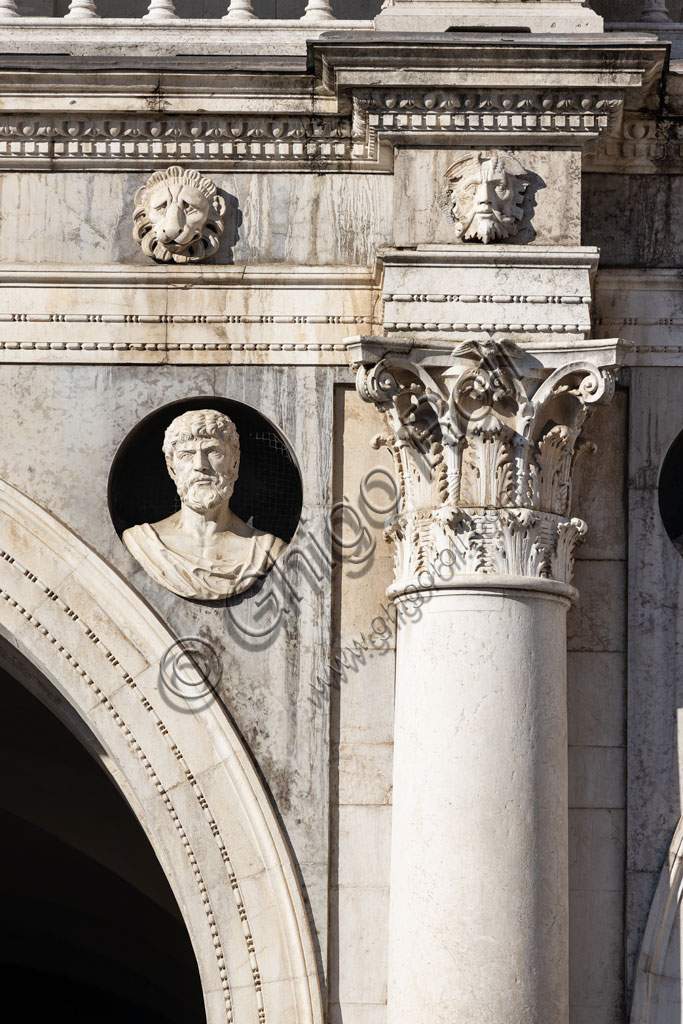 Brescia, piazza della Loggia (a Renaissance square where the Venetian influence is evident), Palazzo della Loggia: detail of the white Botticino marble facade  with a column, a capital and one of the thirty Caesars, a cycle created by Gasparo da Cairano and Tamagnino.