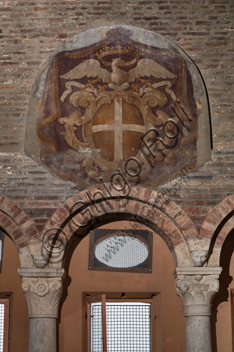 Modena, Ghirlandina Tower, Torresani Hall with works by Campionese Masters, XII - XIII century: detail of the north wall with the emblem of the Modena community and the Estense eagle with the ducal crown.