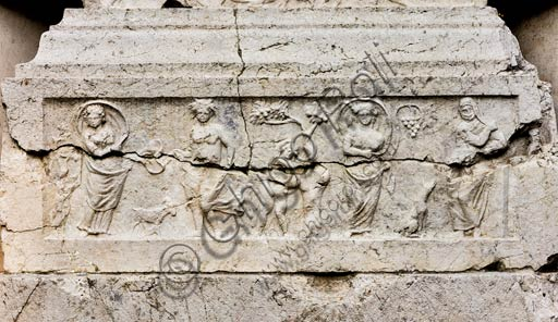 Reggio Emilia, Public Gardens or People Park, the Concordii monument (funeral monument found in Boretto. Roman art of the Imperial age, first century A. D.): detail of the central stele representing the four seasons.