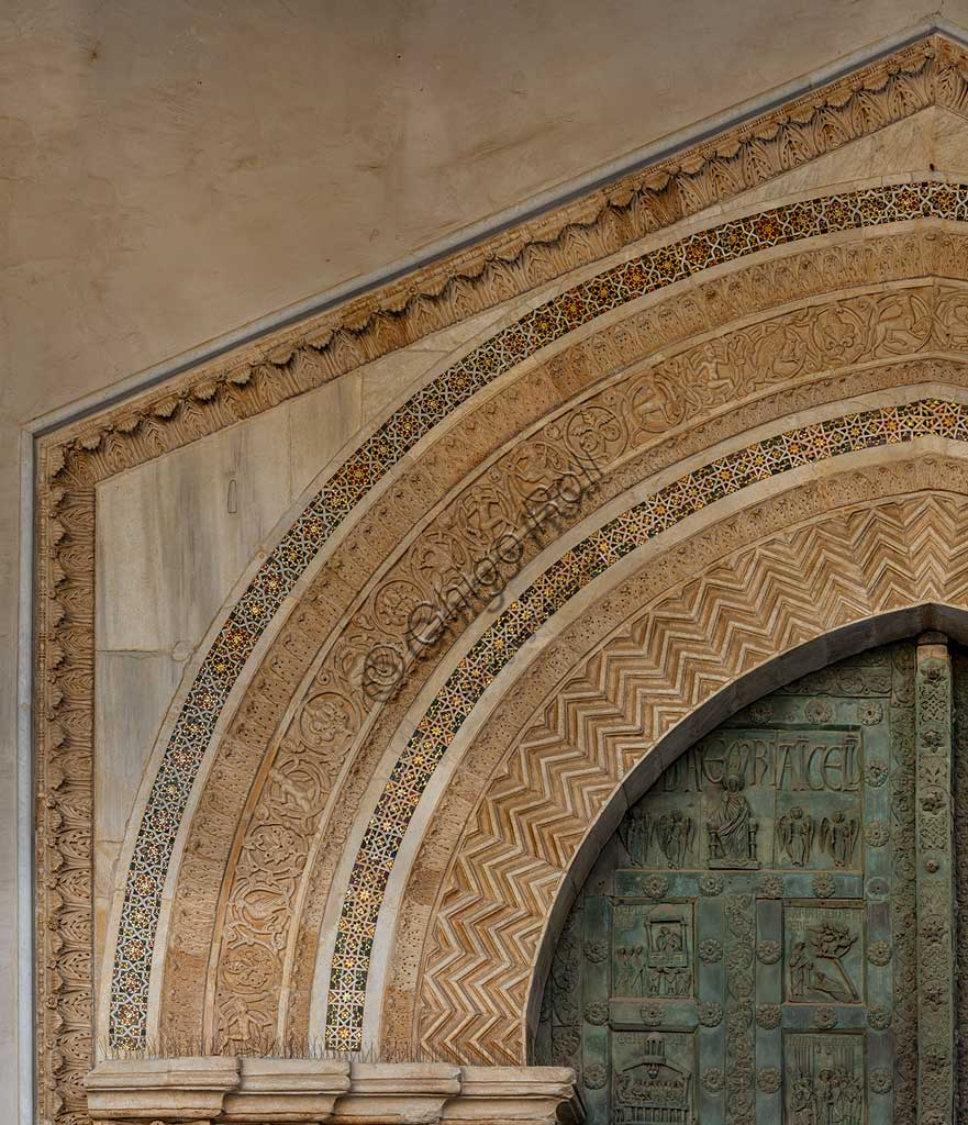 Cathedral of Monreale, main portal: detail of the arch with anthropomorphic figures and animals.