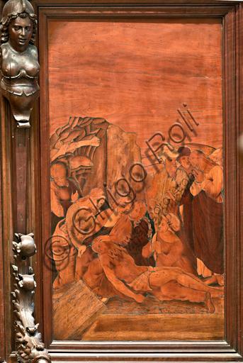 """Genova, Duomo (Cattedrale di S. Lorenzo), interno,  presbiterio, abside, coro, lato sud: """"Deposizione al sepolcro"""", tarsia lignea di Gian Michele De' Pantaleoni (secolo XVI)."""