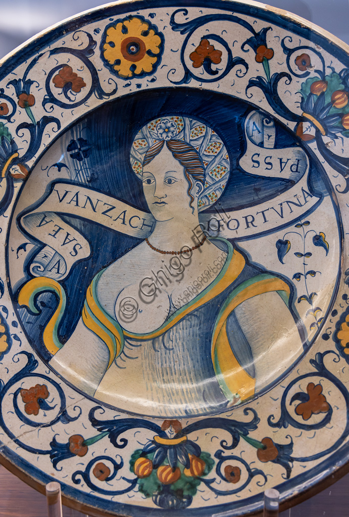 Deruta, Regional Ceramics Museum of Deruta: plate decorated by a beautiful woman's bust, with a  motif, majolica, Deruta, first half of the 16th century.