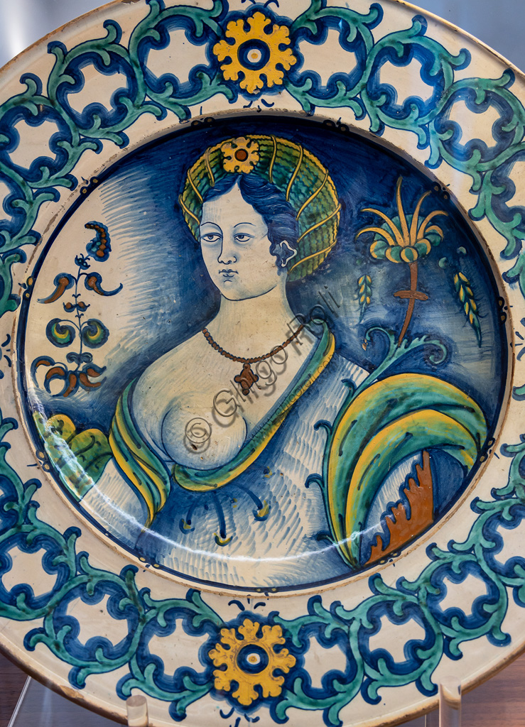 Deruta, Regional Ceramics Museum of Deruta: plate decorated by a beautiful woman's bust, with a crown of thorns motif, majolica, Deruta, first half of the 16th century.
