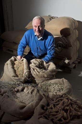 Distilleria Peloni: Egidio Tarantola Peloni, the owner, shows five of the sixteen herbs to brew the Braulio tonic liquor.