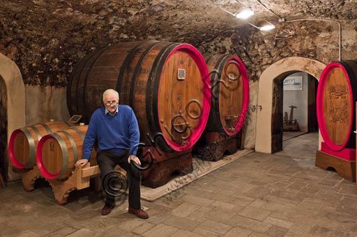 Distilleria Peloni, the cellars: Egidio Tarantola Peloni, the owner beside the barrels for the ageing of Braulio tonic liquor.