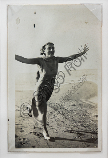 """""""Woman running on the beach with open arms"""", bromide silver gelatine by Marcello Dudovich,  1920-21."""