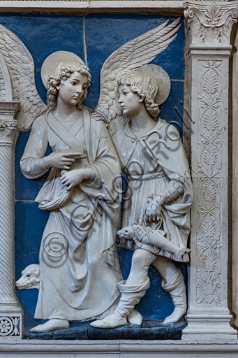"Basilica of the Holy Cross: """"Dossal of an altar with central ciborium"". Detail of Archangel Raphael and Tobias,   by Andrea Della Robbia, about 1475, bas-relief polychrome glazed terracotta."