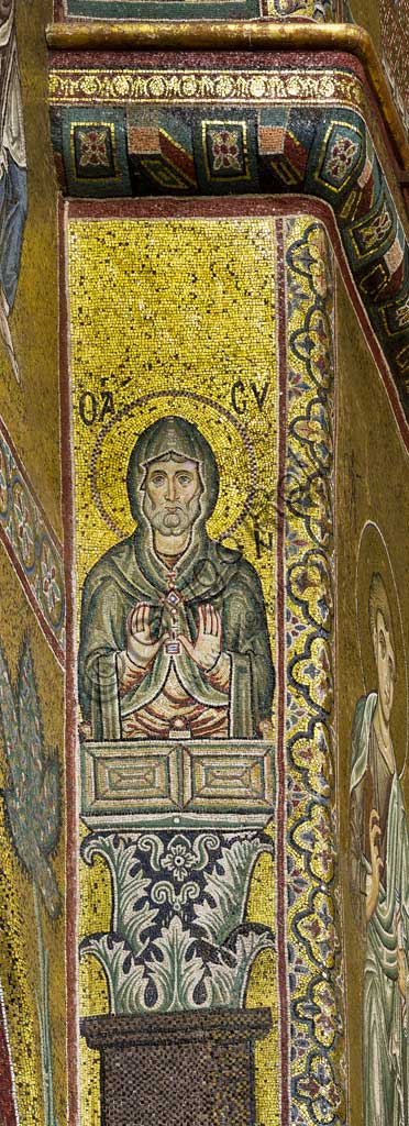 Monreale Cathedral, apse: Saint, byzantine school mosaic with a golden background. The mosaics of the Cathedral were made between the twelfth and mid-thirteenth century by partly local and partly Venetian workers, trained at the Byzantine school.