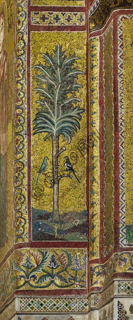 Monreale Cathedral, apse: decoration frieze representing a palm tree and two birds (a magpie and a parrot), byzantine school mosaic with a golden background. The mosaics of the Cathedral were made between the twelfth and mid-thirteenth century by partly local and partly Venetian workers, trained at the Byzantine school.