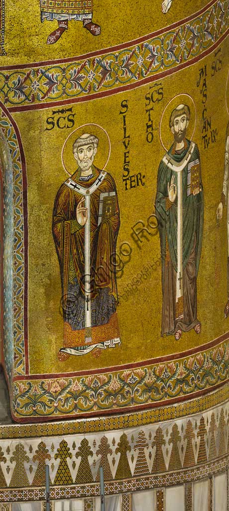 Monreale Cathedral, apse: St Silvester and St. Thomas of Canterbury, byzantine school mosaic with a golden background. The mosaics of the Cathedral were made between the twelfth and mid-thirteenth century by partly local and partly Venetian workers, trained at the Byzantine school.