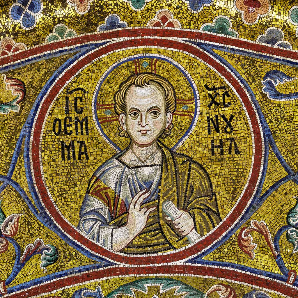 Monreale Cathedral, apsidal arch: Jesus Christ Immanuel, byzantine school mosaic with a golden background. The mosaics of the Cathedral were made between the twelfth and mid-thirteenth century by partly local and partly Venetian workers, trained at the Byzantine school.