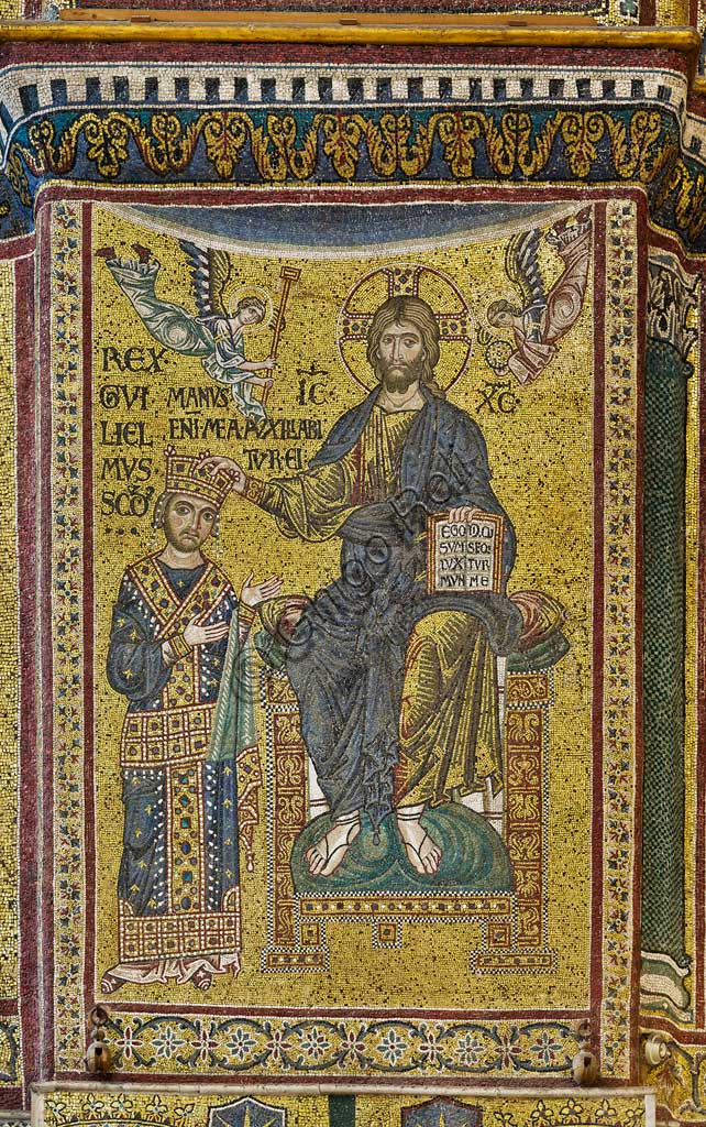 Monreale Cathedral, transept: the Byzantine mosaic which depicts King William II crowned by Christ.The mosaics of the Cathedral were made between the twelfth and mid-thirteenth century by partly local and partly Venetian workers, trained at the Byzantine school.