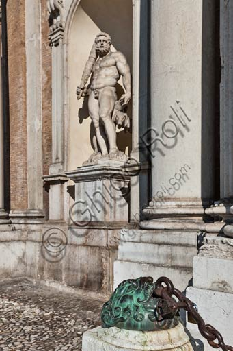 "Modena, the Ducal Palace (seat of the Military Academy), detail of the façade in piazza Roma (Roma square): ""Hercules"", statue by Prospero Sogari (1565) and big mask in braze holding up a chain, by anonymous author (XVII century)."