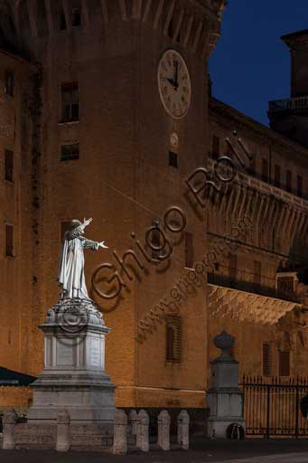 Ferrara: night view of the Castello Estense (the Estense Castle), also known as Castle of St. Michael. In the foreground, the statue of the Ferrara friar Girolamo Savonarola.