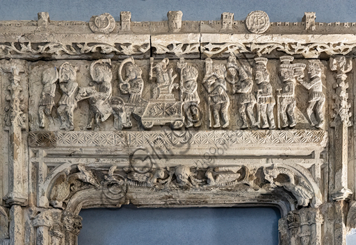 Carved window which had been realised for Marongiu Palace in Sassari at the middle of XVI century in late gothic style. The frieze represents the triumph of Angelo Marongiu in Sassari. The town of Sassari can be recognised with its city walls and towers.Detail.