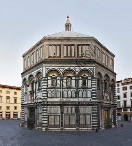Florence, the Baptistery of St. John, exterior: the South  Eastern façade in Carrara white marble and green Prato marble with the door by Andrea Pisano on the South side and the Paradise door  by Lorenzo Ghiberti on the East side.