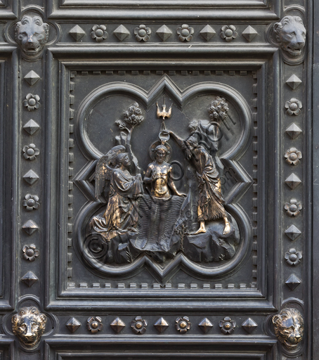 Florence, the Baptistery of St. John, exterior, the South  façade in Carrara white marble and green Prato marble: the door by Andrea Pisano (1330 -1336) with episodes of St. John's the Baptist life, the Cardinal Virtues and the Theological Virtues. Tile with the Baptism of Christ.