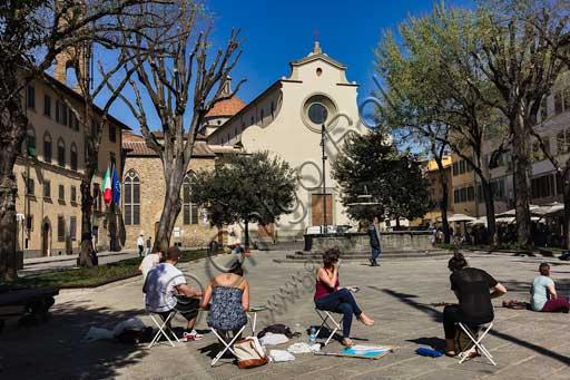 Firenze, piazza Santo Spirito: lezione di pittura. Sullo sfondo, la Basilica di Santo Spirito.