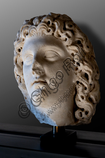 Foligno, Trinci Palace, Archaelogical Collection: one of the seven Roman heads that in the Middle Ages had been placed outside the painted Loggia to symbolize the Seven Ages of Man.  Portrait of ideal young divinity, or Youth (II century a.C).