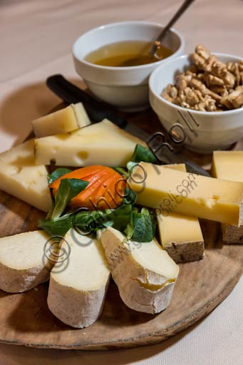 Valtellina typical kinds of cheese served with walnuts and honey.