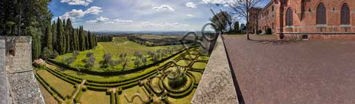 Gaiole in Chianti: view of the Brolio Castle, its gardens and the surrounding countryside with olive trees, vineyards and cypresses.