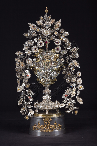 Genoa, Museum of the Treasury of the Cathedral of San Lorenzo: Reliquiary known as the hair of the Virgin; Genoa silversmiths; 18th century; cast, embossed, gilded silver with gems and enamels.