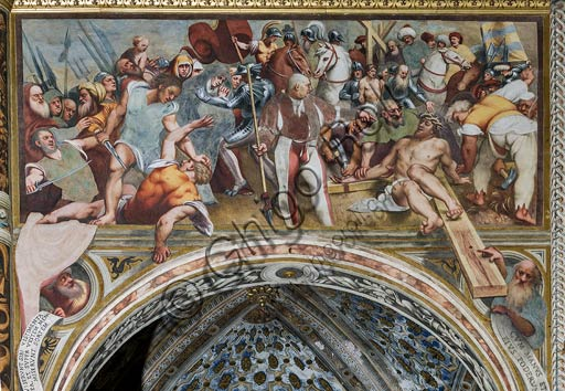 "Cremona, Duomo (the Cathedral of S. Maria Assunta), interior, middle nave, sixteenth arch: ""Jesus is nailed to  the Cross"", fresco by Pordenone (Giovan Antonio de' Sacchis), 1520."