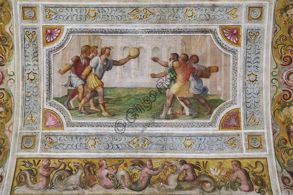 """Ferrara, the Castello Estense (the Estense Castle), also known as Castle of St. Michael: detail of the ceiling of the Hall of Games,""""The game of the ball at the bracelet"""". The frescoes are designed by Pirro Ligorio. The realization  is by Ludovico Settevecchi."""