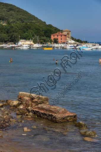 The Baratti Gulf: the Etruscan furnaces found in the beach near the St. Cerbone Church. In the background, the small port.