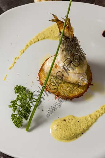 "Venice, ""Al Graspo de Ua"" Restaurant: cornucopia of sea bass on potatoes and with a Bronte pistachio nut sauce."