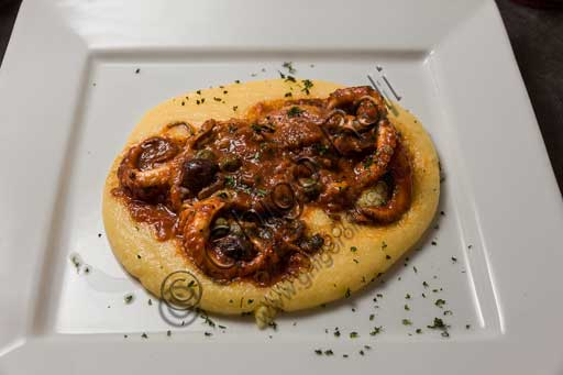 "Venice, ""Al Graspo de Ua"" Restaurant: curled octopus in sauce and Taggiasca olives on a Marano corn cream (similar to polenta)."