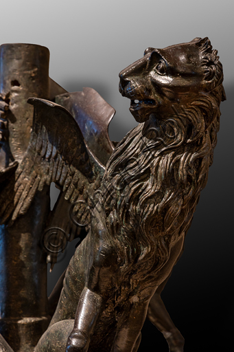"""Perugia, National Gallery of Umbria: """"Griffins and lions """", a bronze group that was part of the sculptures of the Fontana Maggiore, by Umbrian craftsmen, last quarter of the XIII century, bronze. Detail."""