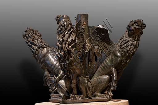 """Perugia, National Gallery of Umbria: """"Griffins and lions """", a bronze group that was part of the sculptures of the Fontana Maggiore, by Umbrian craftsmen, last quarter of the XIII century, bronze."""